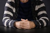 Poor Elderly Woman Sitting At Table, Focus On Hands poster