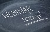 webinar today reminder  - white chalk handwriting on a blackboard poster