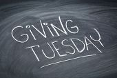 Giving Tuesday  - white chalk handwriting on a  blackboard poster