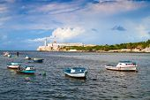Fishing boats in the bay of Havana with El Morro in the background
