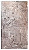 stock photo of sumerian  - Ancient relief of an assyrian winged god - JPG