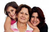 Latin grandmother, daughter and daughter smiling on a white background