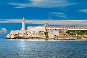 foto of el morro castle  - The Castle of El Morro in the bay of Havana with reflections in the water - JPG