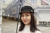 Attractive Beautiful Lady Hold An Umbrella. poster