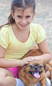 Latin girl with her small pekingese dog