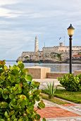 The famous castle of El Morro in Havana seen from a beautiful park across the bay