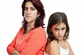 Young latin mother and her daughter mad at each other isolated on white
