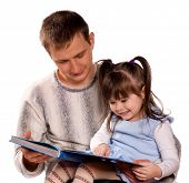 Happy family. Father and child reading a book. Isolated on white background. Beautiful caucasian models.