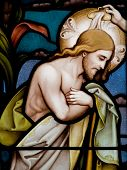 stock photo of baptism  - Stained glass in Catholic church in Dublin showing baptism of Jesus - JPG
