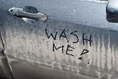 Wash Me Sign On Dirty Car