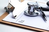 Empty Prescription  Lying On Table With Stethoscope poster
