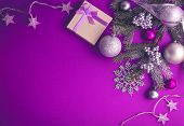 Purple Christmas Background With A Gift, Fir Tree, Toys And Bows poster