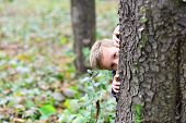 Let Your Kid Play. Little Boy Play Hide And Seek Game. Little Boy Play Nature. Every Day Get Outside poster