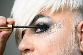 Time For Mascara. Male Makeup Artist. Transgender Man Apply Mascara. Transgender Man Wear Eyeshadows poster