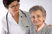 stock photo of health-care  - Health care worker and elderly woman needs help - JPG