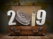 2019 Happy new year. Vintage suitcase with number 2019 as Coloisseum and Big Ben tower. Travel and t poster