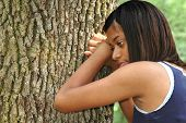 foto of black american  - Teen feeling sad rejected and alone outdoors - JPG