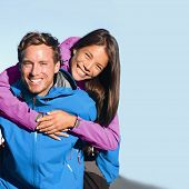 Happy hikers couple living an active lifestyle hugging laughing outdoors on trek hike nature. Health poster