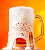 Beer pver orange background
