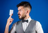 Man Bearded Hipster Hold Plastic Blank Card Blue Background. Take This Card. Make Shopping Easy. Ban poster