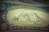 Money background - US dollars background, retro style toned photo with shallow DOF