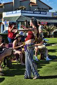 CARLSBAD, CALIFORNIA - SEPTEMBER 2: Dancer Megan Amelia Burnette and drummers gather for a joyous rh