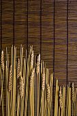 Bamboo Board With Spaghetti And Grain poster