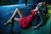 Sexy woman wearing red dress