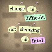 The saying or motto Change is Difficult, Not Changing is Fatal with words stuck onto a bulletin boar
