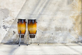 stock photo of congas  - two congas in front of a vintage wall - JPG