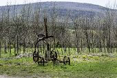 picture of sulky  - A vintage sulky plow rests in a field in Schoharie New York - JPG