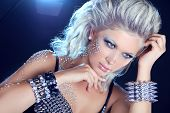 Hairstyle. Fashion Beauty Girl. Punk Style Woman With Strasses On Face, On A Night Lights Background