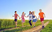 stock photo of hilltop  - happy children shoot on field in summer time - JPG