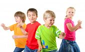 stock photo of schoolboys  - happy children dancing on a white background - JPG