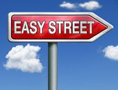 stock photo of comfort  - easy street road sign arrow indicating easy solutions or a way to avoid problems safe way taking risk comfortable comfort zone secure route safe way - JPG