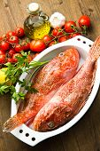 stock photo of redfish  - two Redfish on white bowl with some ingredients - JPG