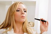 stock photo of e-cigarettes  - young beauty girl with e - JPG