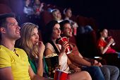 stock photo of audience  - Young people sitting in multiplex movie theater - JPG