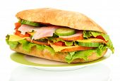 Fresh and tasty sandwich with ham and vegetables isolated on white