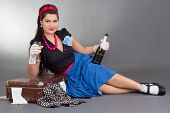 Pinup Girl With Bottle Of Champagne And Packed Suitcase