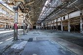 image of rafters  - Abandoned industrial warehouse with exposed rafters and light