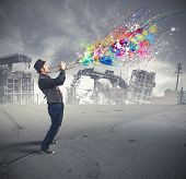 stock photo of trumpets  - A trumpeter with a colorful splash effect - JPG