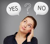 stock photo of yes  - Business woman thinking yes or on in speech bubble on grey background - JPG