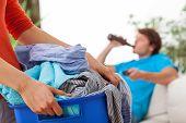 Woman Holding Laundry
