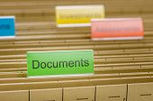 A hanging file folder labeled with Documents