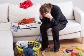 stock photo of housekeeping  - Woman who work and care of house is exhausted and stressed of her workload - JPG