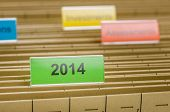 A hanging file folder labeled with 2014
