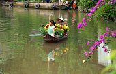 Women And Children On Rowboat With Flower Fortet In Springtime