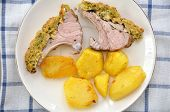Rack of lamb in a herb crust with potatoes and salad