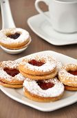 stock photo of linzer  - Traditional home made Linzer Cookies filled with jam - JPG